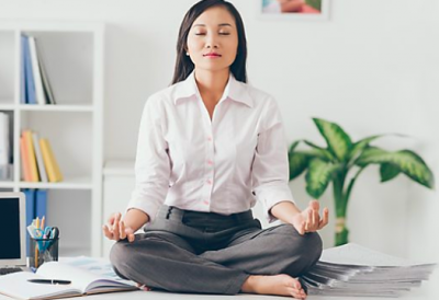 Woman in lotus position at work