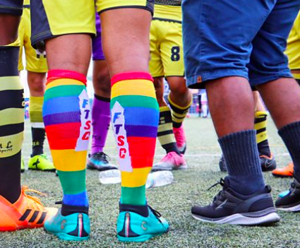 Footballer wearing rainbow-coloured socks