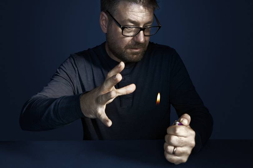 Gustav Kuhn performing a magic trick with a lighter
